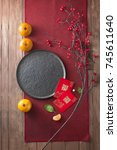 Small photo of Flat lay Chinese new year food and drink table top shot still life. Translation on text appear in image: Prosperity.