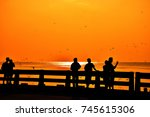 silhouette of people or... | Shutterstock . vector #745615306