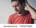 forgetful absent minded man is... | Shutterstock . vector #745637860
