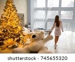 girl in her house on christmas... | Shutterstock . vector #745655320