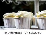 white cupcake on cakestand... | Shutterstock . vector #745662760