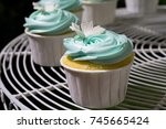 blue cupcake on cakestand... | Shutterstock . vector #745665424
