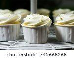 white cupcake on cakestand... | Shutterstock . vector #745668268
