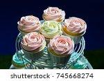 white cupcake   pink cupcake... | Shutterstock . vector #745668274