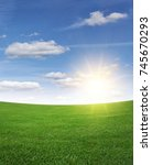 green grass field and blue sky... | Shutterstock . vector #745670293