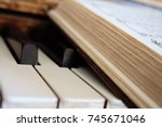 hymnal book on piano keys