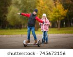 children drive scooter and... | Shutterstock . vector #745672156