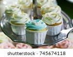 blue cupcake on cakestand  ... | Shutterstock . vector #745674118