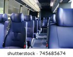 rows of blue leather seats... | Shutterstock . vector #745685674