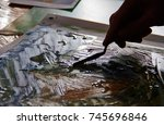 the artist's hand in the... | Shutterstock . vector #745696846