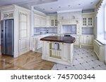 modern design white kitchen in...   Shutterstock . vector #745700344