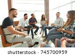 employees at the seminar on... | Shutterstock . vector #745700959
