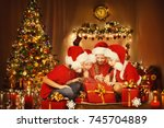 christmas children open present ... | Shutterstock . vector #745704889