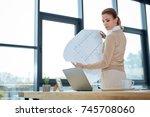 waist up of occupied engineer   Shutterstock . vector #745708060