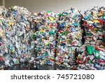 Small photo of Plastic bales at the waste processing plant. Separate garbage collection. Recycling and storage of waste for further disposal, trash sorting. Business for sorting and processing of waste.