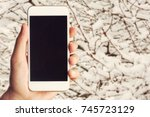 hand with phone. | Shutterstock . vector #745723129