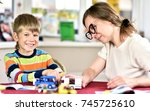 mother with her son is playing...   Shutterstock . vector #745725610
