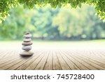 zen stones on empty wooden with ... | Shutterstock . vector #745728400