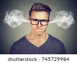 angry young man  blowing steam... | Shutterstock . vector #745729984