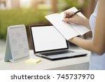 businesswoman planning agenda... | Shutterstock . vector #745737970