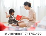 asian young mother is looking...   Shutterstock . vector #745761430