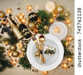 christmas table setting. gold...   Shutterstock . vector #745762138