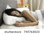 pretty young woman sleeping... | Shutterstock . vector #745763023