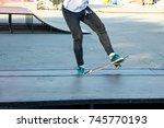 skateboarder legs riding... | Shutterstock . vector #745770193