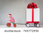 happy child with christmas gift.... | Shutterstock . vector #745772950