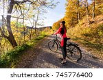 young active girl with bicycle... | Shutterstock . vector #745776400