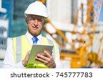 senior engineer man in suit and ... | Shutterstock . vector #745777783