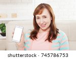 female hand holding white phone ...