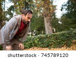 man having short rest to take a ... | Shutterstock . vector #745789120