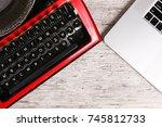Old Typewriter And Laptop On...
