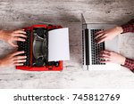 old typewriter and laptop on... | Shutterstock . vector #745812769