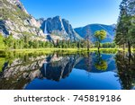 Yosemite National Park - Reflection in Merced River of Yosemite waterfalls and beautiful mountain landscape, hiking in the beautiful nature of California, USA