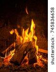 a fire burns in a fireplace ... | Shutterstock . vector #745836658