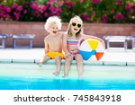 kids playing at outdoor... | Shutterstock . vector #745843918
