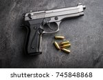 9mm pistol bullets and handgun...