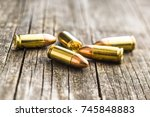 9mm pistol bullets on old... | Shutterstock . vector #745848883