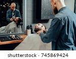 barbershop theme. bald bearded... | Shutterstock . vector #745869424