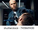 barbershop theme. bald bearded... | Shutterstock . vector #745869430