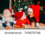 mom and her sons in red hats... | Shutterstock . vector #745870768