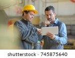 contemplative manual workers... | Shutterstock . vector #745875640