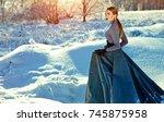 beautiful young girl in a long... | Shutterstock . vector #745875958