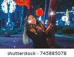 smiling teenage girl on the... | Shutterstock . vector #745885078
