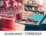 women wearing red sweater...   Shutterstock . vector #745885264
