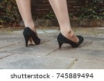 woman twists ankle in high... | Shutterstock . vector #745889494