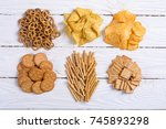 mix of snacks   pretzels  ... | Shutterstock . vector #745893298
