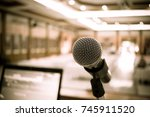 microphone on abstract blurred... | Shutterstock . vector #745911520